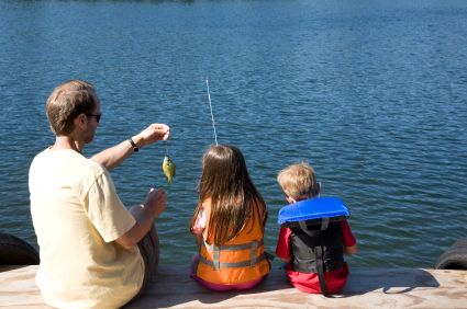 father fishing with 2 children